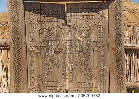 Carved Wooden Vintage And Ancient Gate. Ancient Background.