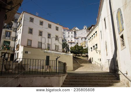 San Miguel Staircases Amongst Old Buildings In Alfama Disctrict, The Most Famous And Ancient Typical