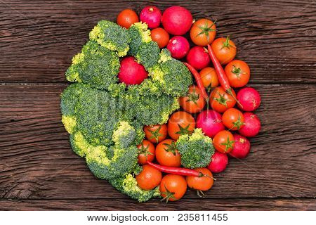 Healthy Eating, Food, Dieting And Vegetarian Concept - Red And Green Vegetables Arranged In Yin And