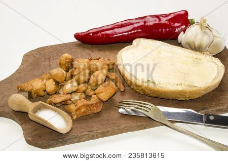 Hungarian Breakfast With Bread With Butter, Greaves, Red Paprika, Garlic And Fine Salt