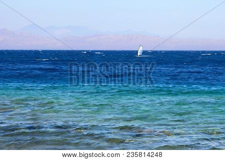 View Of Beautiful Waters Of Red Sea And Windsurfer In Distance
