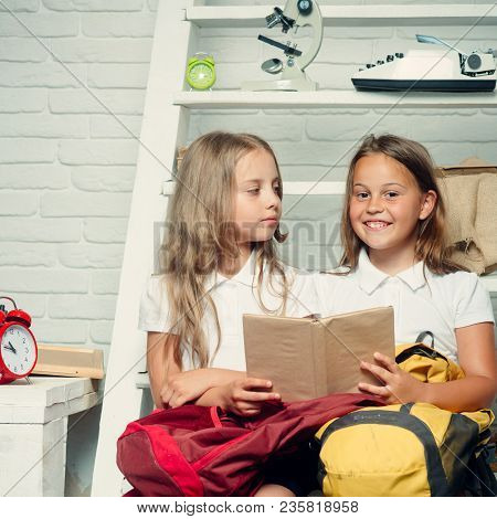 Reading An Intereseting Story. Reading And Learning With Two Curious Children Holding Book.
