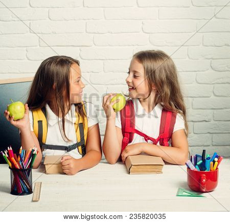 Back To School And Home Schooling. Little Girls Eat Apple At Lunch Break. School Time Of Girls. Frie