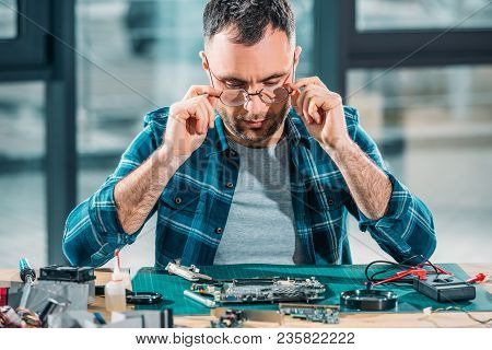 Hardware Engineer In Glasses Working With Pc Parts