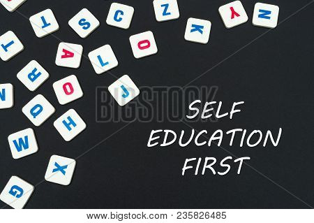 English School Concept, Text Self Education First, Colored Square English Letters Scattered On Black