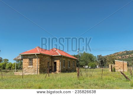 Modderpoort, South Africa - March 12, 2018: An Old, Unused, Sandstone Building With Outside Toilet,