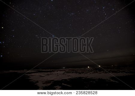 A Landscape Of Stars Shine In The Night Sky In Iceland