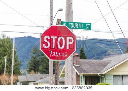 Stop Sign With Handwritten Word On It, Reading