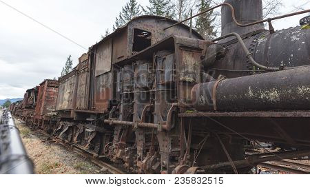Rusted And Worn Out Train Engine On Tracks In Snoqualmie, Washington, Usa.