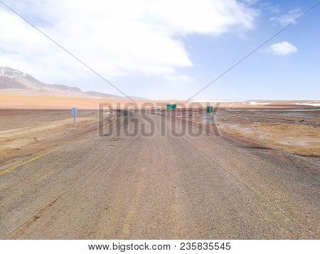 Chilean Border Road Sign,chile. Border Across Chile And Bolivia. Andes Altiplano