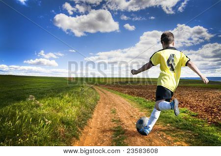 Freedom. Boy playing football