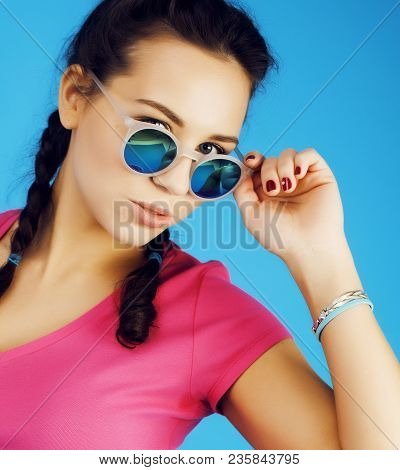 Young Pretty Woman Cheerful Happy Smiling, Posing On Blue Background, Lifestyle People Concept Close