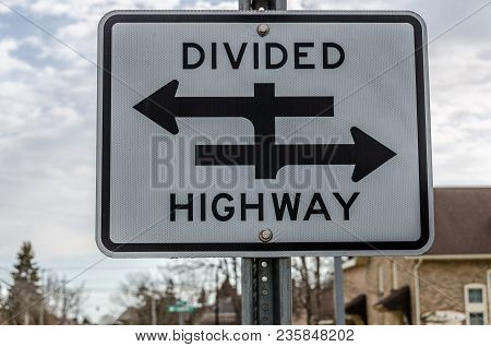 Black And White Sign To Warn Of A Divided Highway At The Next Intersection