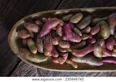 Rustic Wooden Bowl Filled With Melloco Tuber  Closeup In Ecuador