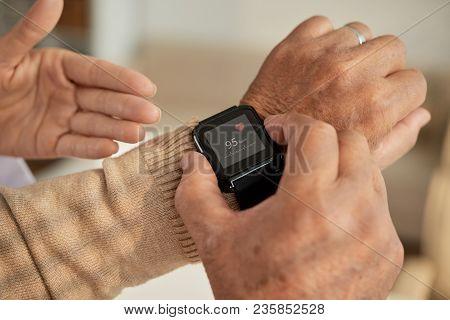 Senior Man Setting Health Application In His Smart Watch