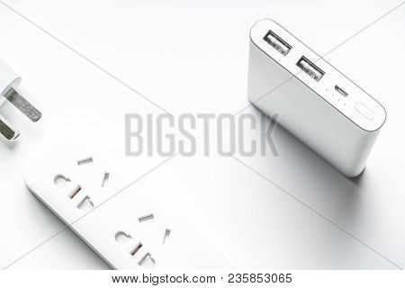Socket Plug Electric Power Bar And White Silver Power Bank Isolate. Save Energy And Reduce Energy Ef