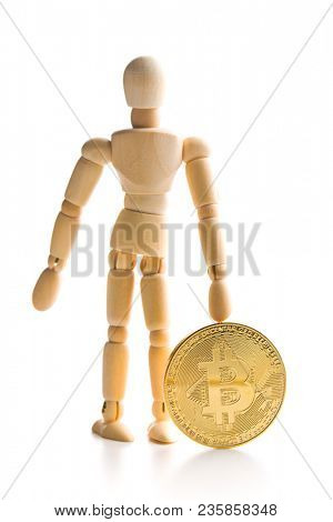 Bitcoin currency and wooden puppet isolated on white background.