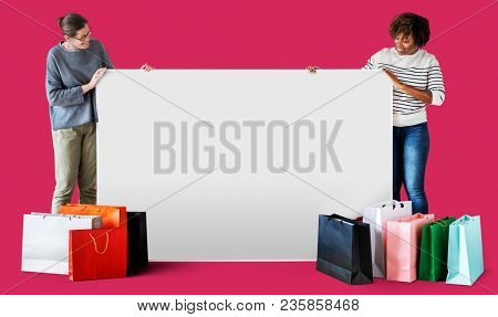Women with shopping bags and a banner