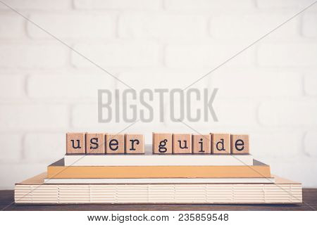 The Word User Guide, Text On Wooden Cubes On Top Of Books. Background Copy Space, Vintage Minimal. C