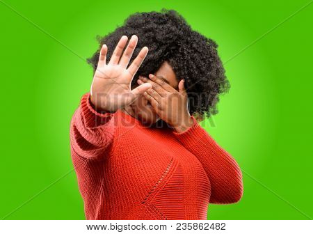 Beautiful african woman stressful and shy keeping hand on head, tired and frustrated