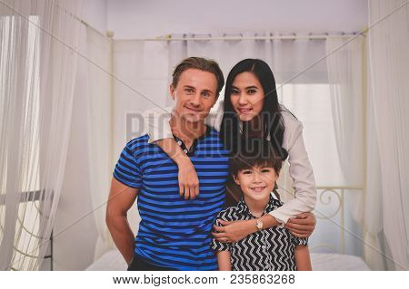 Family Concept. Family Is Happy In The House. Family Is Doing Activities In The Bedroom. The Family