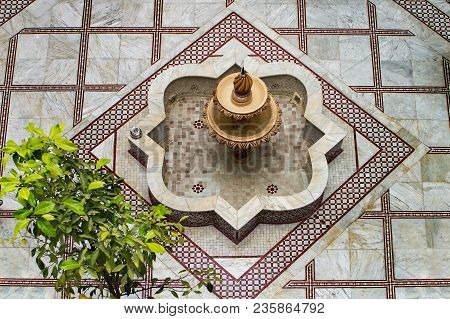 Ceramic Decorated Fountain And Plant. Top View.
