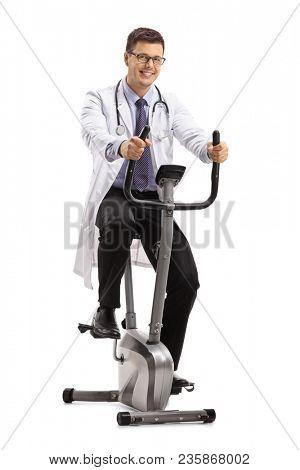 Doctor exercising on a stationary bike isolated on white background
