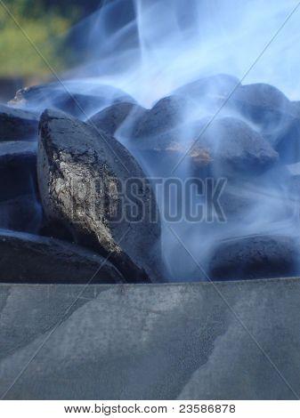 Smoking Charcoal Briquets