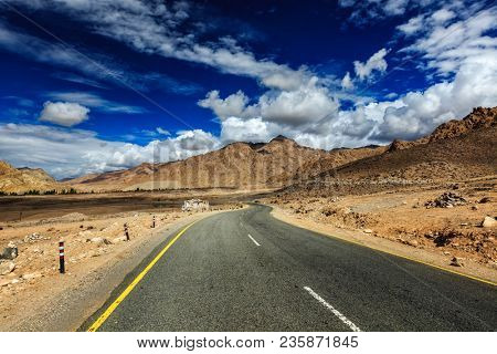 Travel forward journey concept background - Road National Highway 1 (Srinagar-Leh Highway) asphalt road in Himalayas. Ladakh, Jammu and Kashmir, India