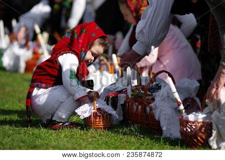BREB, ROMANIA - 09 APRIL, 2018 - Local peasants dressed in traditional clothes, celebrating the Easter Holidays in Breb Village, Maramures, Romania