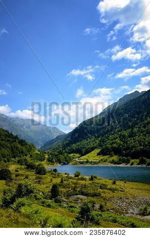 Mountain landscape at Fabreges lake in Ossau Valley in French Pyrenees. Bearn, Atlantic-Pyrenees, Aquitaine, France