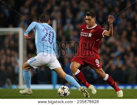 MANCHESTER, ENGLAND - APRIL 10: Bernardo Silva  and Roberto Firmino  during the Champions League quarter final match between Manchester City and Liverpool at the Etihad Stadium on April 10, 2018