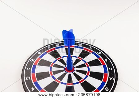 Blue Dart Arrow On Center Of Dartboard On White Background, In Concept Of Opportunity And Success In