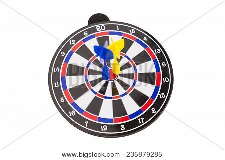 Blue And Yellow Dart Arrow Hitting On Center Of Dartboard Isolated On White Background, In Concept O
