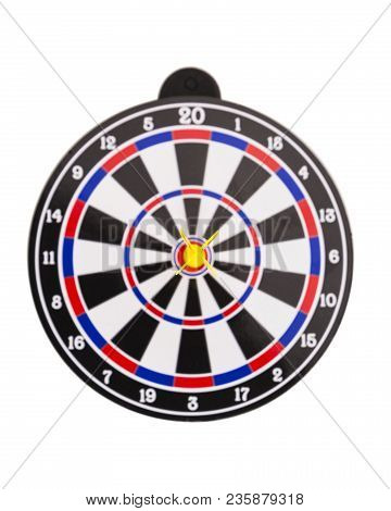Blur Dartboard With Yellow Dart Hitting On The Center Isolated On White Background, In Concept Of Op