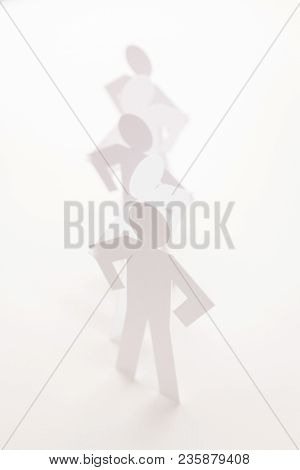 Linked Line Of Five  Paper Standing Figure On Bright White Background. In Concept Of Business, Coope