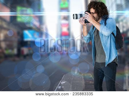 photographer taking a photo in the city. Blurred lights and flares everywhere.