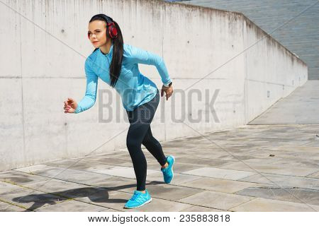 Young and sporty woman training outdoor