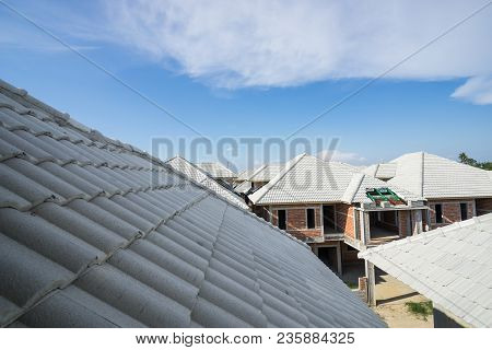 Focus On Roof On House Construction On Blue Sky - Can Use To Display Or Montage On Product