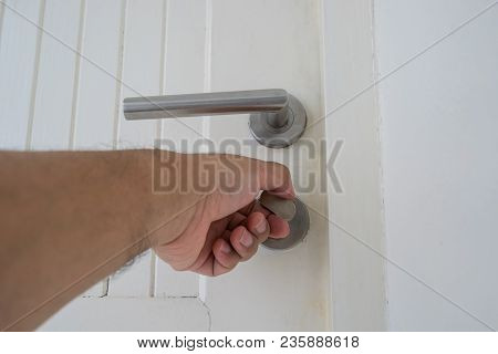 Locksmith Try To Open Lock On Old White Wood Door - Can Use To Display Or Montage On Product
