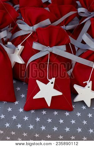 Red Fabric Pouches With White  Big Stars.