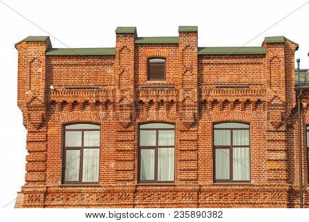 Facade Of The Three-storey Red Brick Building On White Background