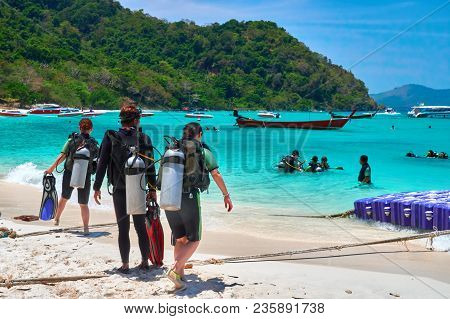 Thailand, Phuket, March 16, 2018-a Group Of Divers Is On The Seashore. Divers With Diving Equipment