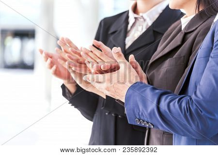 Business People Clapping Hands In The Meeting