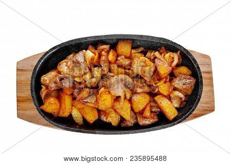 Potato With Mushrooms And Onions, Fried, Baked Portion On A Hot Frying Pan, On A Wooden Board On A W