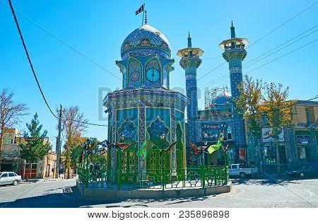Rayen, Iran - Octotber 16, 2017: The Circular Traffic In Inqilab (revolution) Square With Shia Shrin