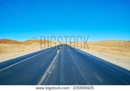 The Straight Road In Desert With Yellow Rocky Hills On Both Sides, Kaluts Of Shahdad, Iran.
