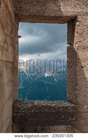 Cloudy Sky And Mountains View From A Window In Italian Dolomites Alps.