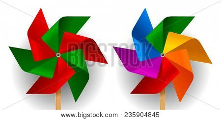 Two multi colored toy paper windmills with six blades
