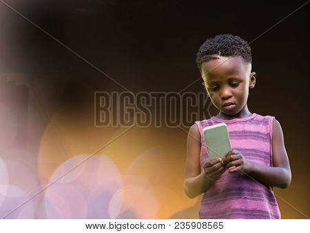 Little boy texting in colored fog